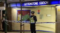 Policeman standing outside Leytonstone Tube station