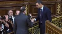 Mariano Rajoy and Pedro Sanchez shake hands