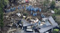 Rescue workers conduct a search and rescue operation following a landslide in Minamiaso, Japan