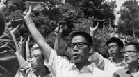 A mob shouting Communist slogans