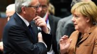 European Commission president Jean-Claude Juncker (l) and German chancellor Angela Merkel (r) talking prior to a meeting of EU leaders on Europe migrant crisis