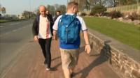 Kieran walking backwards