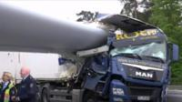 Turbine blade piercing side of lorry's cab
