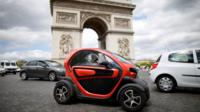 An electric car from Renault, drives past the Arc de Triomphe in Paris on 30 May 2017