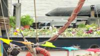 Jo Cox's Thames houseboat covered in flowers