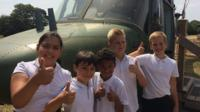 Pupils with the helicopter at their school