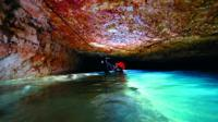Spanish scuba diver Xisco Gràcia exploring an underwater caves