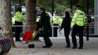 Person wheeled in chair by emergency services