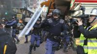 Riot police move in on protesters in Hong Kong