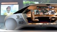 Panasonic shows off a concept car with windows that can swap out the real view for one you prefer.