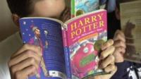 Teenagers reading Harry Potter books