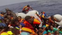 Italy's Coast Guard handles dozens of distress calls from migrants every day - in this case from 100 migrants who say they are at imminent risk of drowning.
