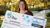 Lottery winner Jacqui Shannon holding £1 million cheque