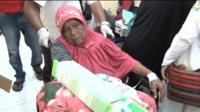 A woman in a wheelchair at a hospital