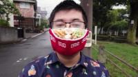 Man wearing a ramen face mask
