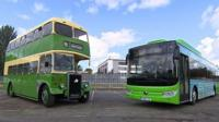 An old fashioned bus next to a new style bus