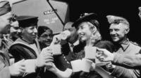 Dame Vera Lynn having tea with servicemen