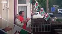 A couple applaud in Penygraig