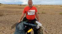 Jason Alexander collecting litter on Suffolk beaches