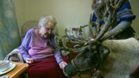 A reindeer visits a woman in an elderly care home