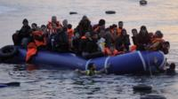 Refugees and migrants arrive by dinghy from Turkey to Greece