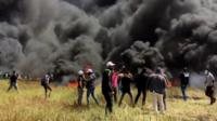 Palestinian protesters clash with Israeli forces on Israel-Gaza border (6 April 2018)