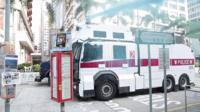 Hong Kong police fire blue water at protesters outside a mosque in Hong Kong