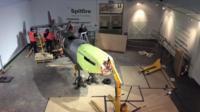 A Spitfire plane is dismantled.