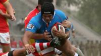 India score a try in a rugby sevens game against China