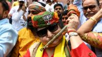 A female BJP supporter celebrates