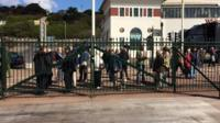 People queue to walk on the new Hastings Pier