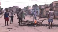 Demonstrators burn wooden pallets in the street