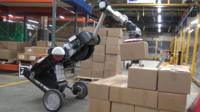 A robot handling packages in a factory