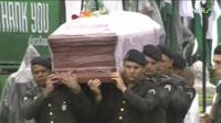 Men carry the coffin of one of the plane crash victims