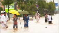 People walking through floods in Japan
