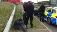 Police intercept migrants who have crossed into the UK