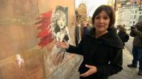 Anjana Gadgil in front of the Banksy