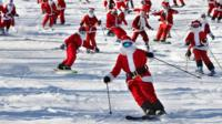 Skiing and snowboarding Santas