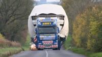 Abnormal load spans both sides of the road