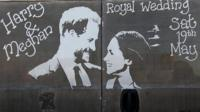 Picture of Prince Harry and Meghan Markle drawn in mud