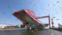 China's new aircraft carrier surrounded by streamers
