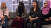 Three women wearing different types of Islamic dress and another without