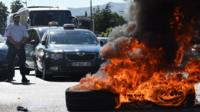 Tyres set on fire by protesting taxi drivers in Marseille, France