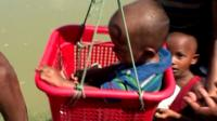 Child in a basket