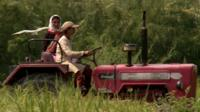 Rimppi and her sister Karamjit driving their tractor