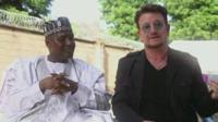 Aliko Dangote (l) and Bono