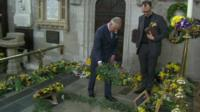 Prince Charles lays a wreath