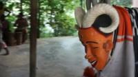 Masked dancer in Ivory Coast