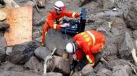 A rescue team searches for life