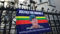 A banner in support of Sergeant Alexander Blackman hangs outside the Royal Courts of Justice